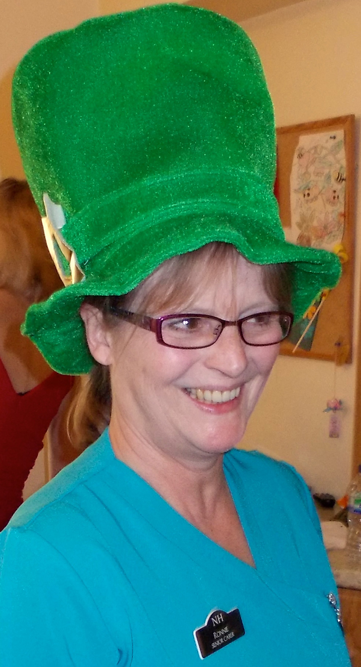 Photo of a lady with green hat