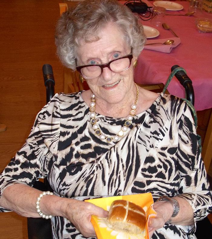 Photo of a lady holding cross bun