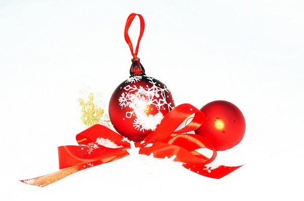 Christmas tree toy, red bow, Snowflake in snow on white backgrou